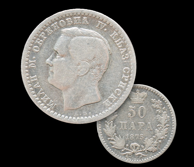 Dinastija Obrenović – odlikovanja i novac: Prvi srebrni novac, naš najlepši i najređi kovani novac – iskovan je 1875. godine u Carsko-kraljevskoj  kovnici u Beču.